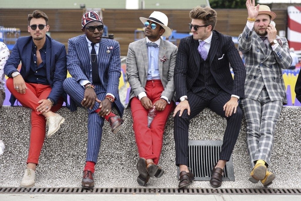 The Pitti peacocks and trendsetters showcase their flair and bizarre outfits.