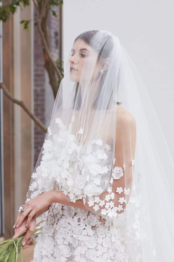 Wedding dress by Oscar de La Renta with 3D flowers, 2018